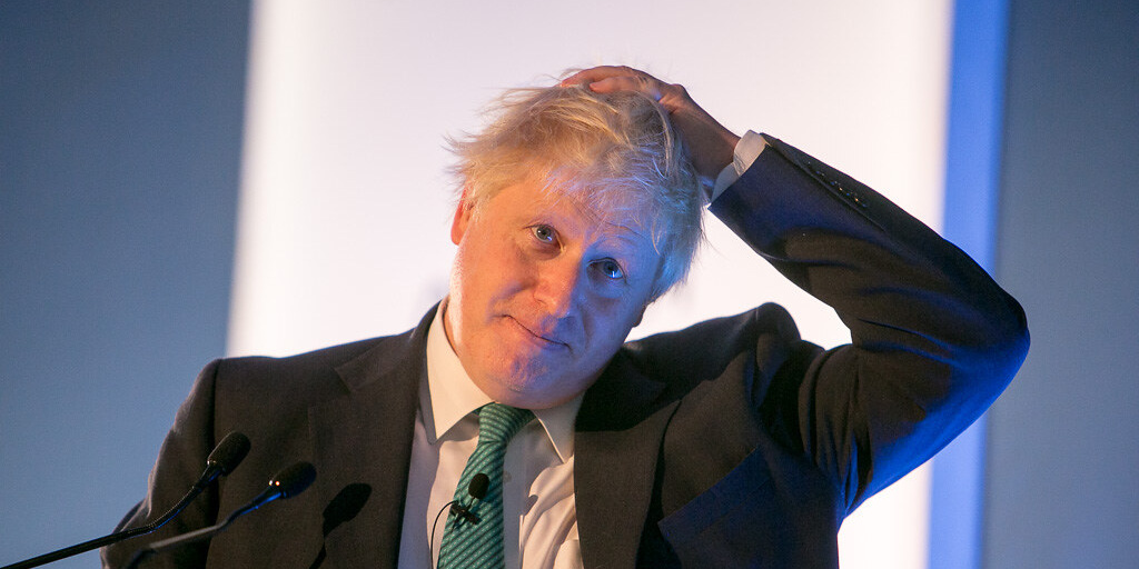 Photo of Boris with his hand on his head