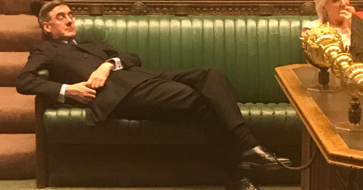 Photo of Jacob Rees-Mogg lying back on the front bench in House of Commons
