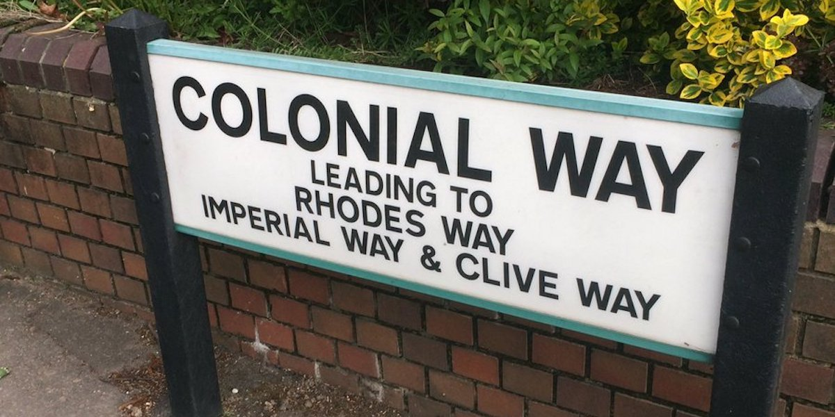 A street sign in Watford marks Colonial Way leading to Rhodes Way, Imperial Way and Clive Way