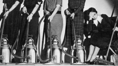 Old advertisement featuring happy housewives with vaccuum cleaners and one sad housewife with dustpan and brush