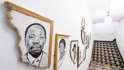 A section of the exhibition showing an arrangement of monochrome portraits
