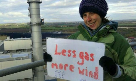 Protester above power station