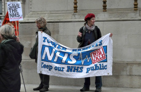 Woman holding banner on demonstration to save the NHS