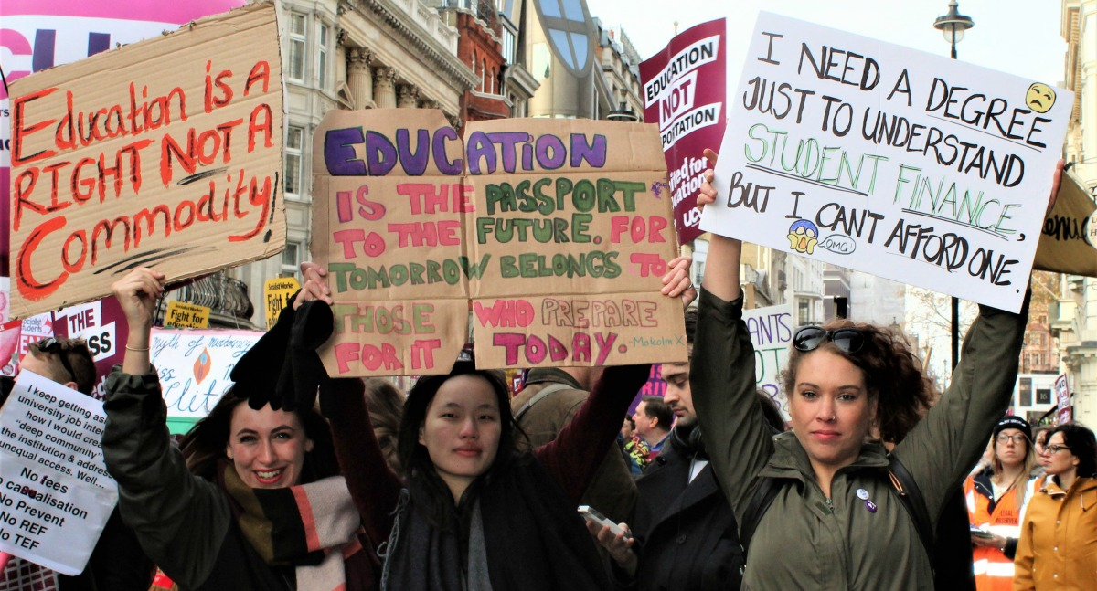 education-demo-three-women-with-placards